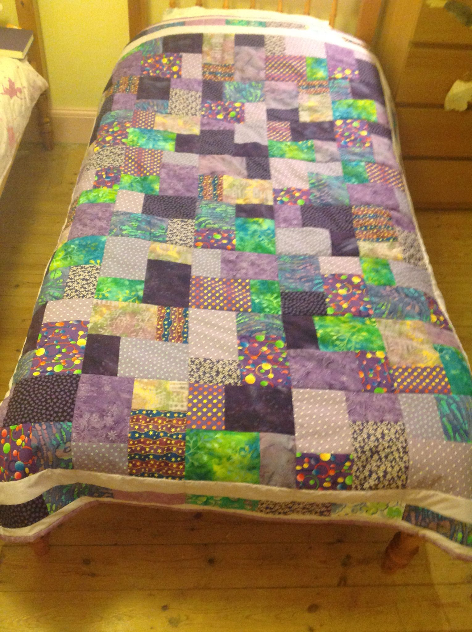 Eleanor's quilt.  The purple project is complete.