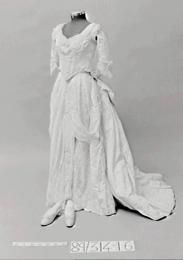 Wedding dress and shoes, 1887. Ivory silk faille with machine made Valencienne style lace trim, heavily beaded with large 'pearls' and small white glass beads.