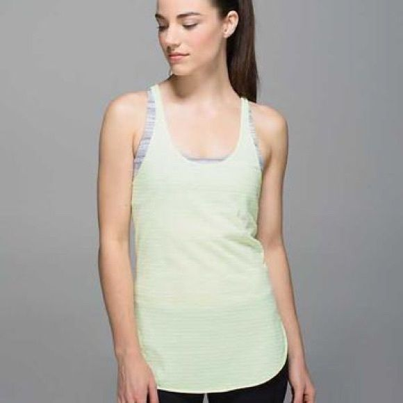 Lululemon What the Sport Tank Top Light green stripes. Wonderful top for everything, light comfortable material. Just making space for new stuff to buy ☺️ size 8. Great condition, no flaws and only washed and hung to dry with other lulu. Rip tag off. lululemon athletica Tops Tank Tops