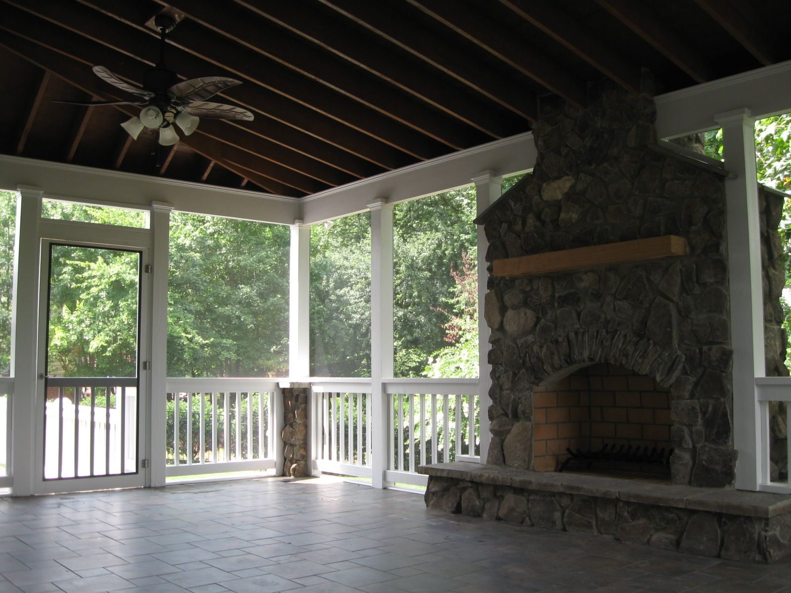 Screened covered patio with fireplace living Deck fireplace designs