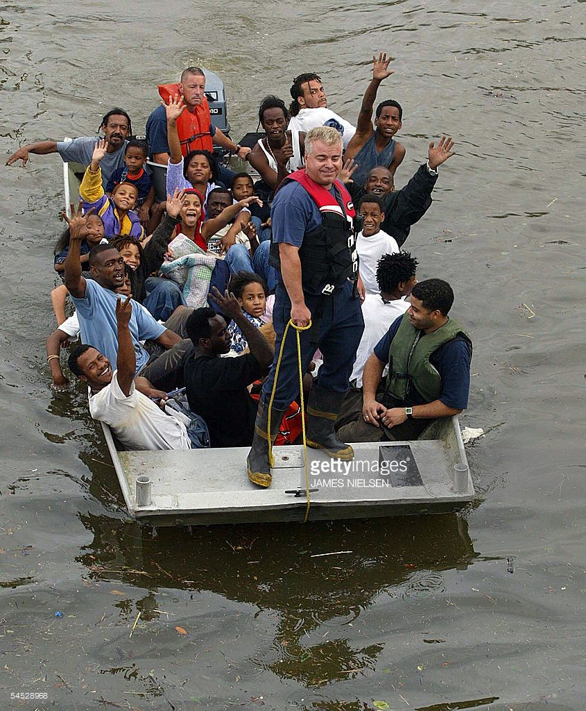 Rescued Victims Of Hurricane Katrina Wave From A Boat 29 August 2005 The Eye Of Katrina Made Landfall Just East Of New Orleans 2 Hurricane Katrina Hurricane Matthew Eye Of The Storm
