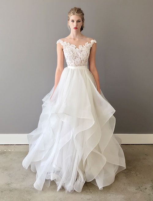Josephine Off The Shoulders Illusion Wedding Dress In A Full Length Handkerchief Silhouette With Horsehair Braid Featuring Hand Sched Lace Bodice