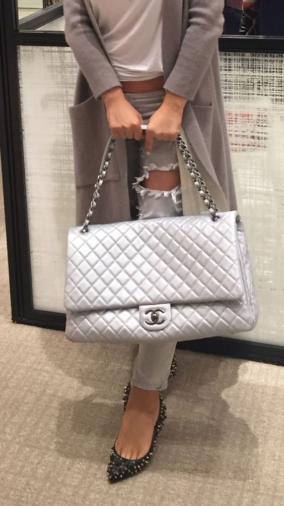 407b42a8c7df Jumbo silver quilted Chanel bag street style casual chic