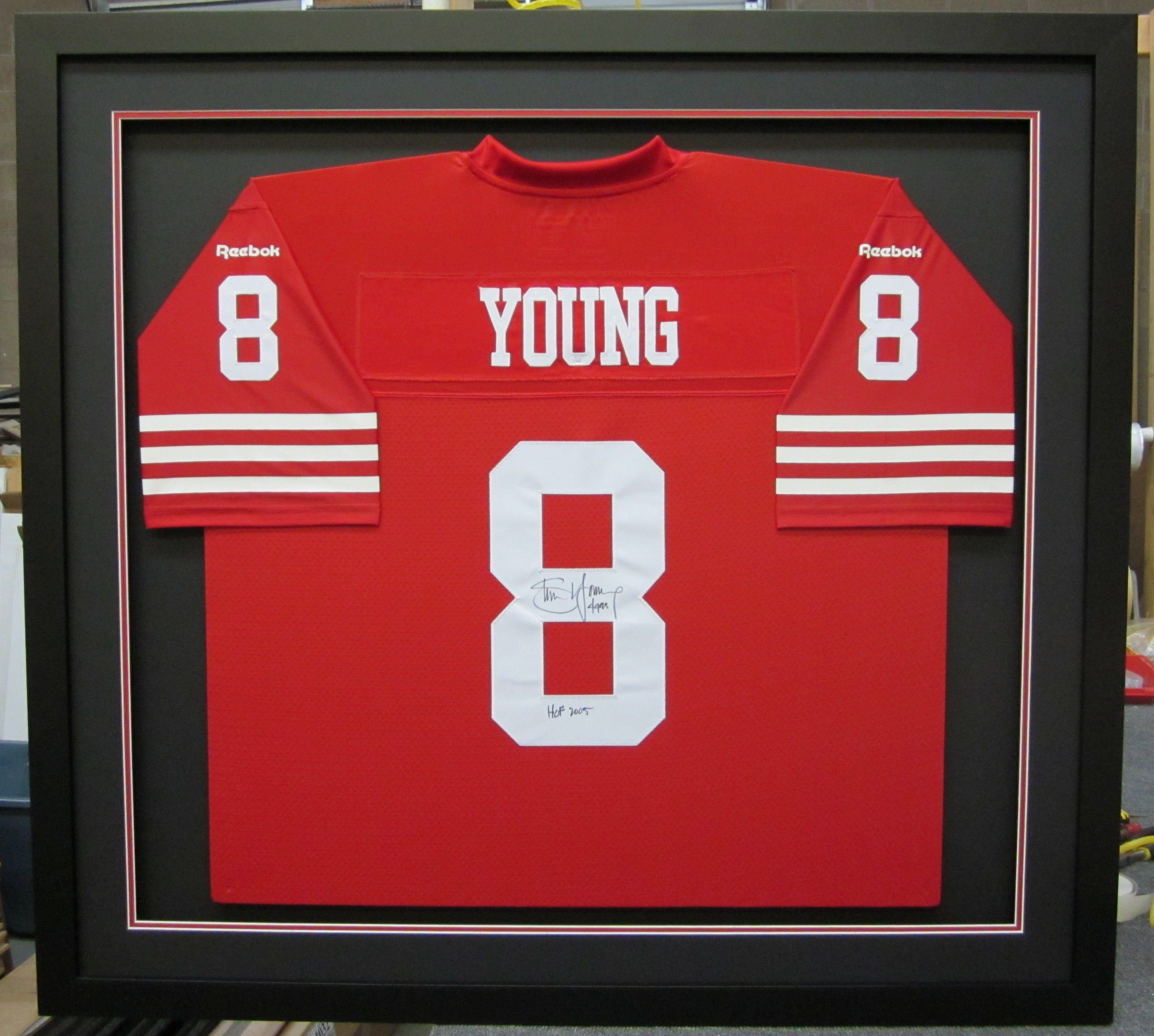 signed 49ers steve young jersey. beautifully framed. larson-juhl