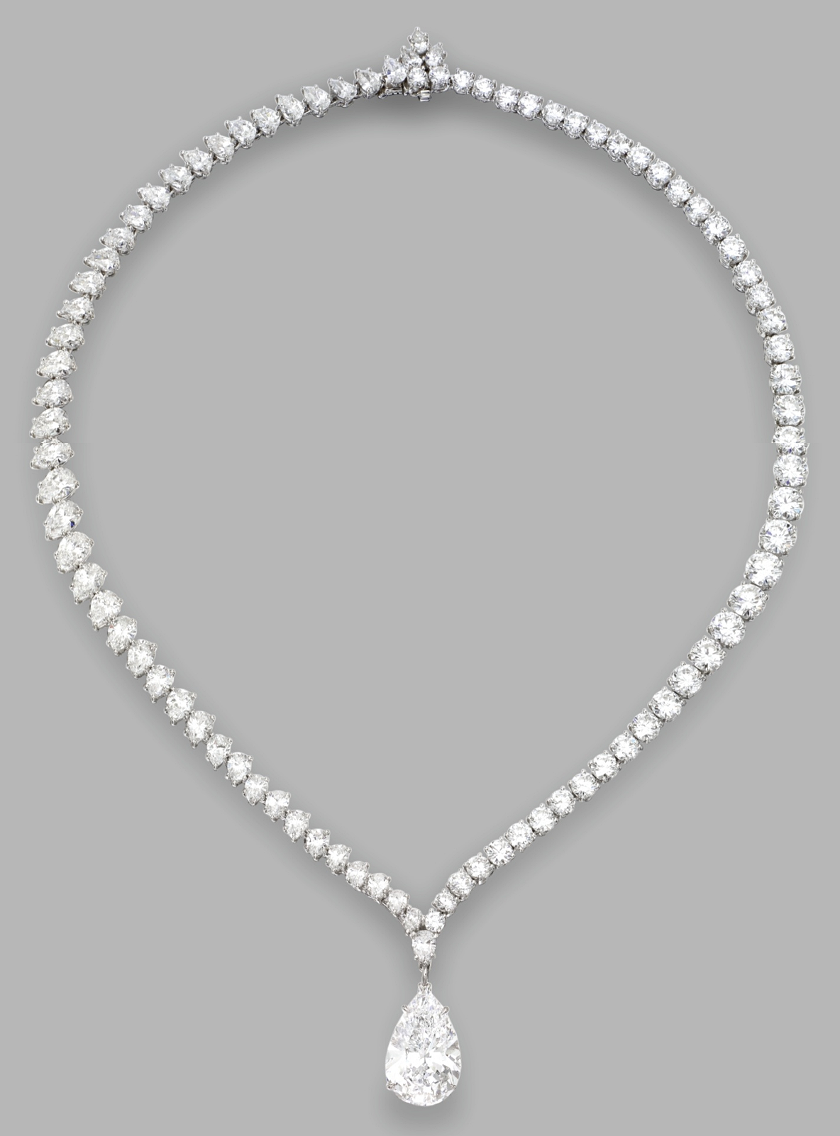 A highly important platinum and diamond pendant necklace harry a highly important platinum and diamond pendant necklace harry winston the pear shaped diamond weighing 1002 carats completed by a necklace set with aloadofball Images