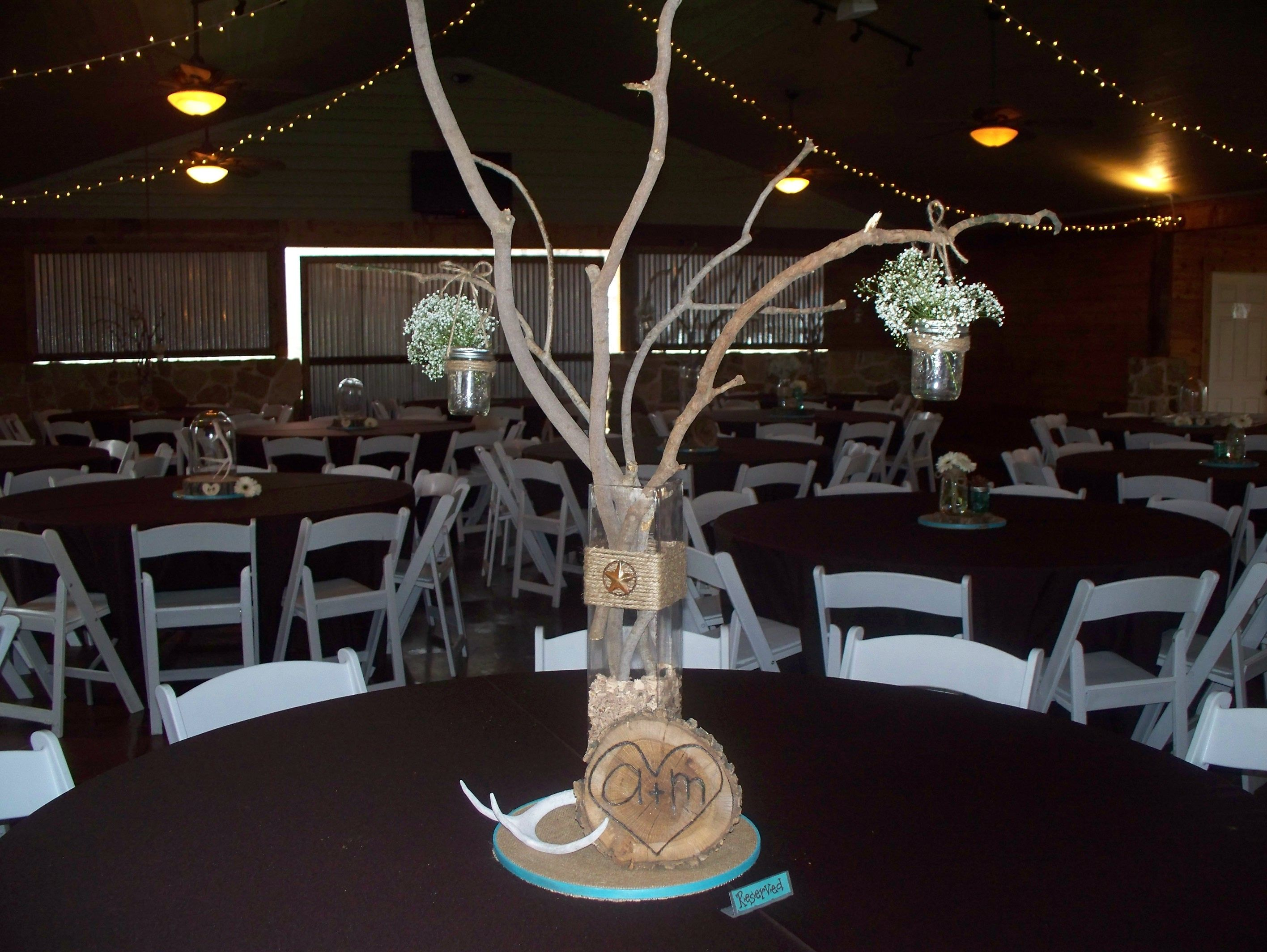 Mason jars on tree branch Centerpieces