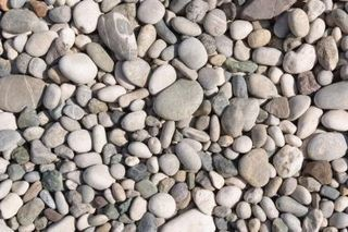 How To Remove Grass Replace It With Rocks Ehow Landscaping With Rocks Rock Flower Beds River Rock Landscaping