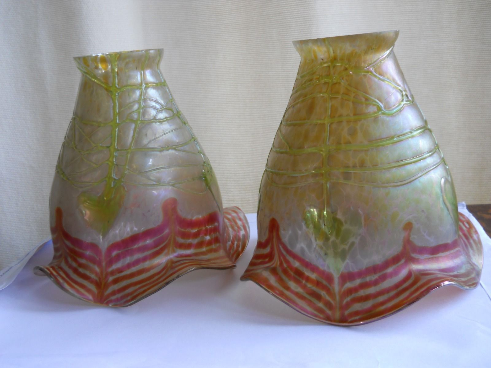"""A Pair of Decorative Art/Art Nouveau Loetz/Krallik Art Glass Shades.  They are Loetz or Krallik with an art nouveau motif of organic form in red and green.  They are approx 5.5"""" or 140mm high They are approx 6"""" or 150mm wide at the flared end. The fitter rim is approx 2"""" or 50mm.   eBay"""