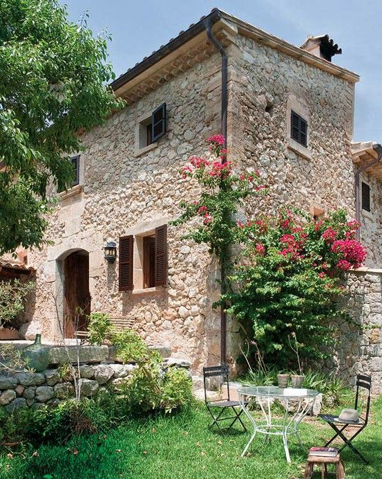 A Country Villa In Mallorca Spain With Bare Stone Walls And Pebble Floors