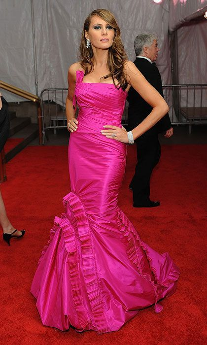 Melania brought the ruffles and glamour wearing a strapless pink trumpet gown to the 2008 Met Gala, Superheroes: Fashion and Fantasy.