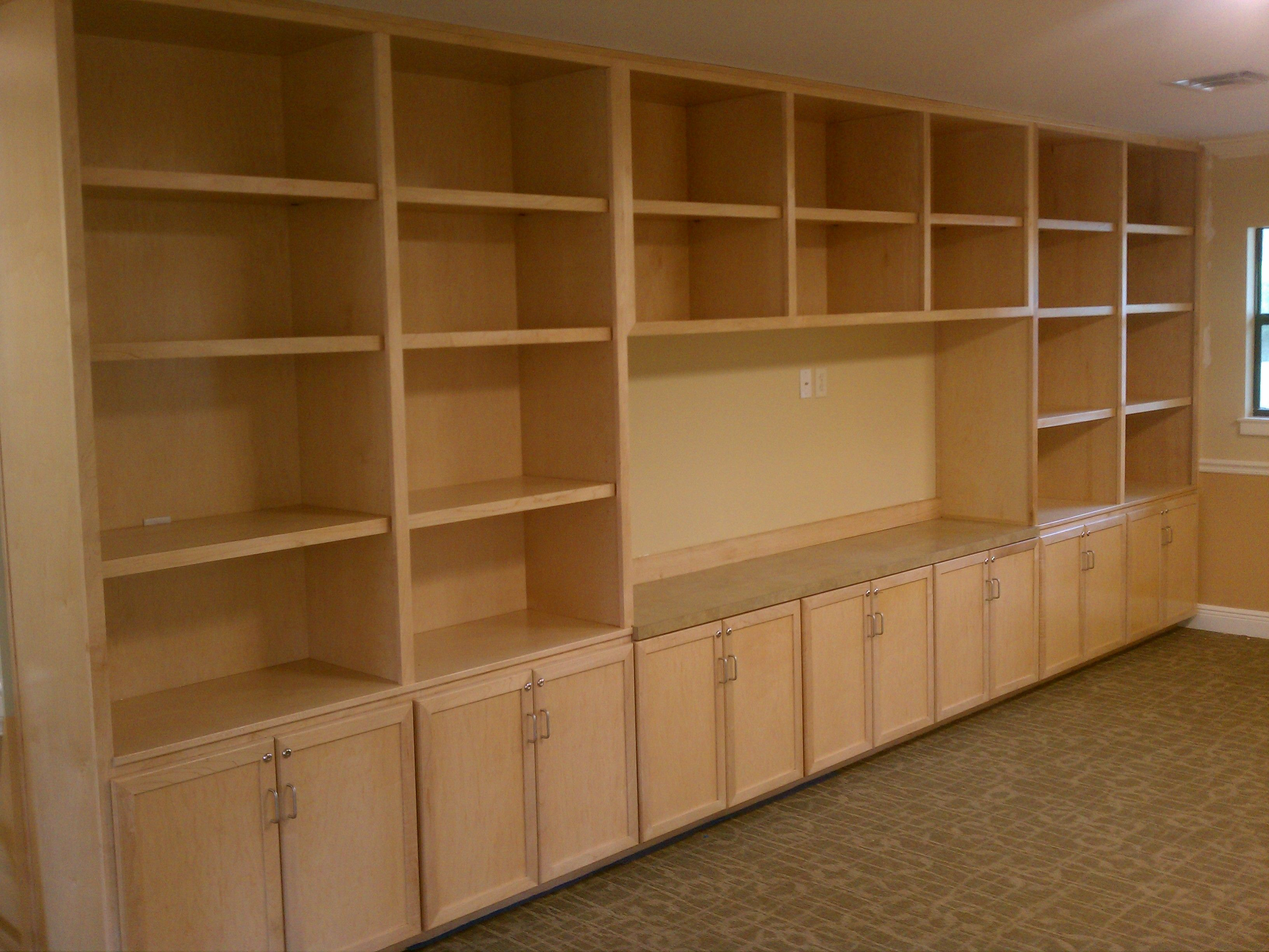 built in white storage cupboard and random shelves built from