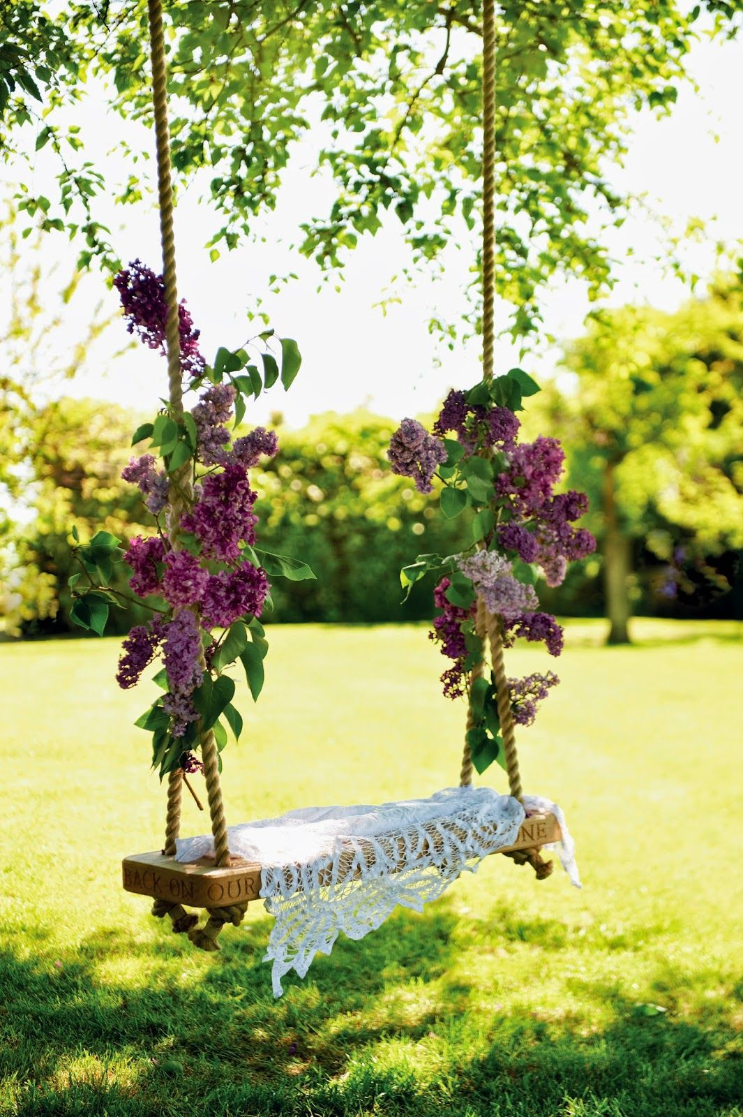 Lilac branches tied to a garden swing Full details on