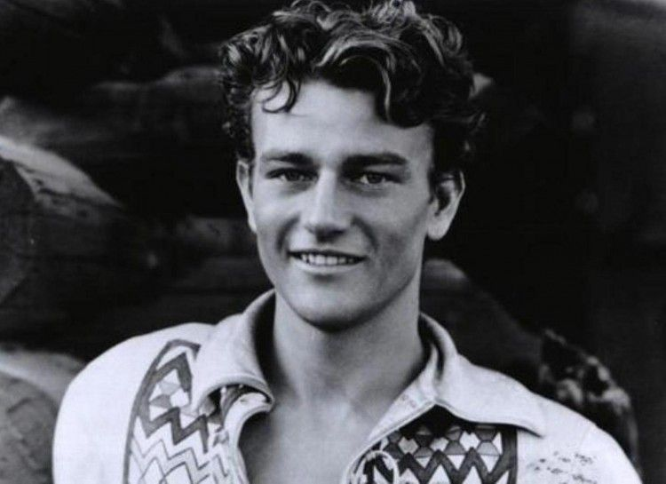 """Accidentally Famous: 18 Stars Who Made Their Debut As An Extra - clipd.com John Wayne was not always the epitome of the rugged cowboy. He was an extra in several films before he landed a starring role in """"The Big Trail"""" in 1930."""