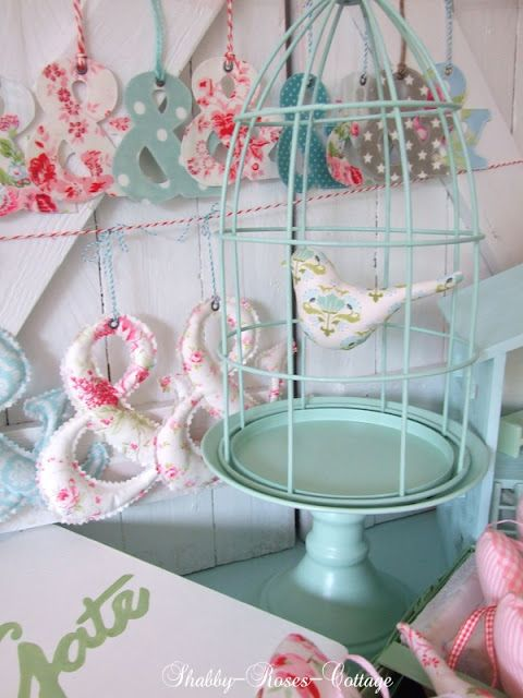 LOVE the birdcage Idea...only I'd make it brown with a tan bird :)