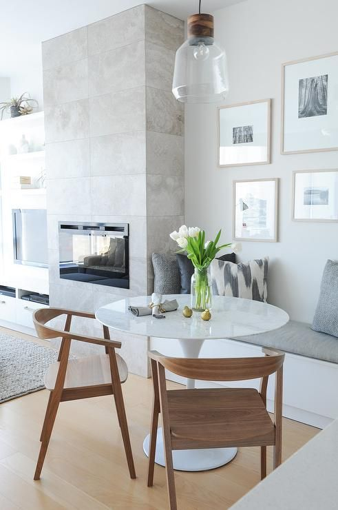 Beautifully Appointed Dining Room Is Positioned Beside A Fireplace And Fitted With White Built In