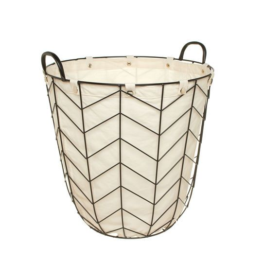 Oval basket in iron with twin handles. Fabric lining with snap-button fastening.