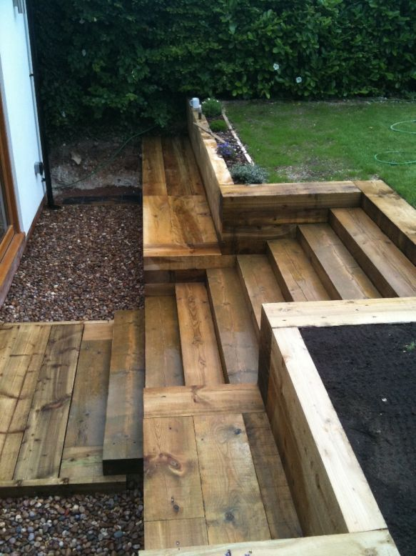 steps walls patio with new railway sleepers
