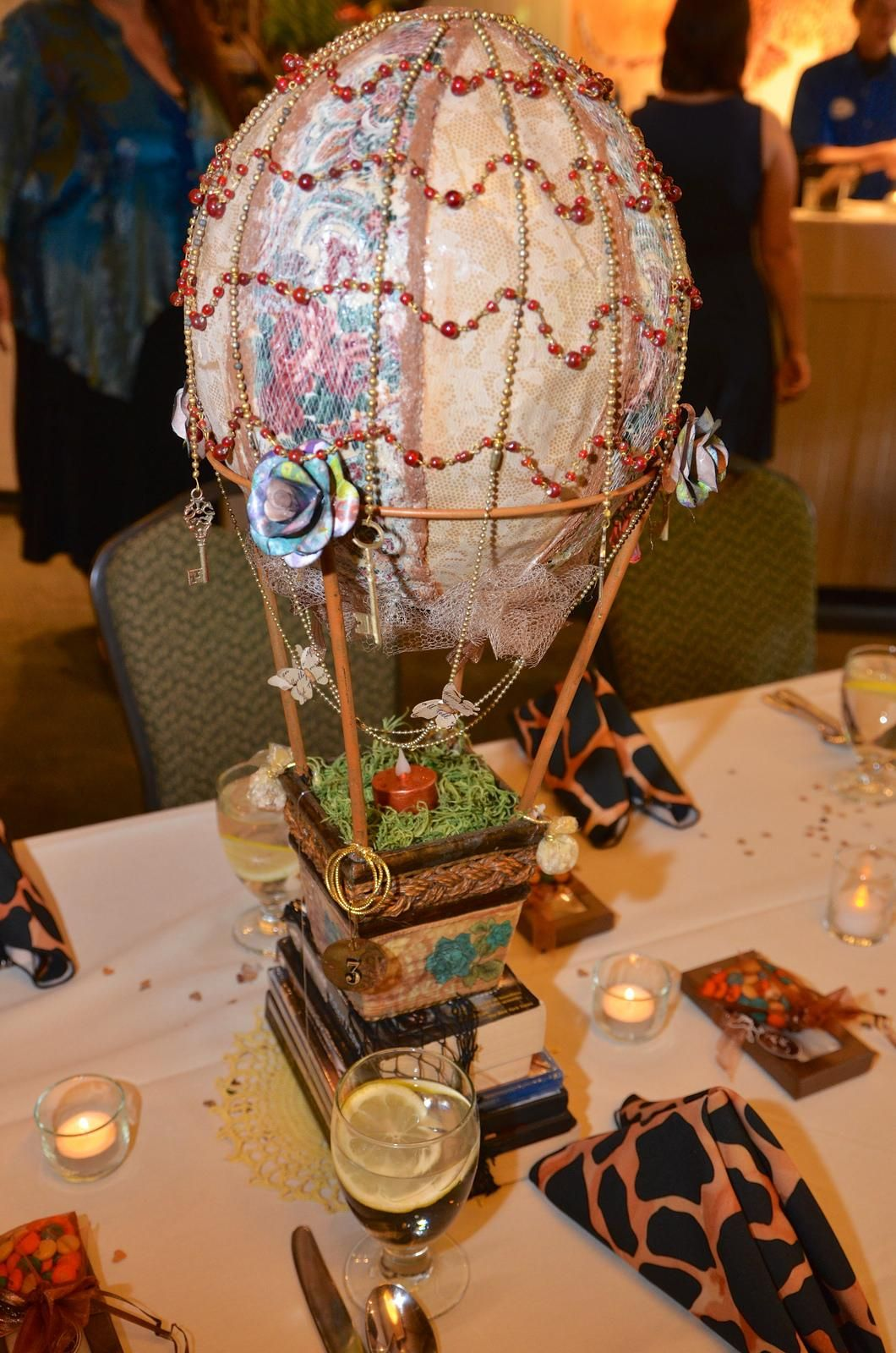 Each Centerpiece Was A Balloon Airship That Sat Atop Cargo Net Full Of Our Favorite Steampunk CircusGothic SteampunkSteampunk Wedding Themes