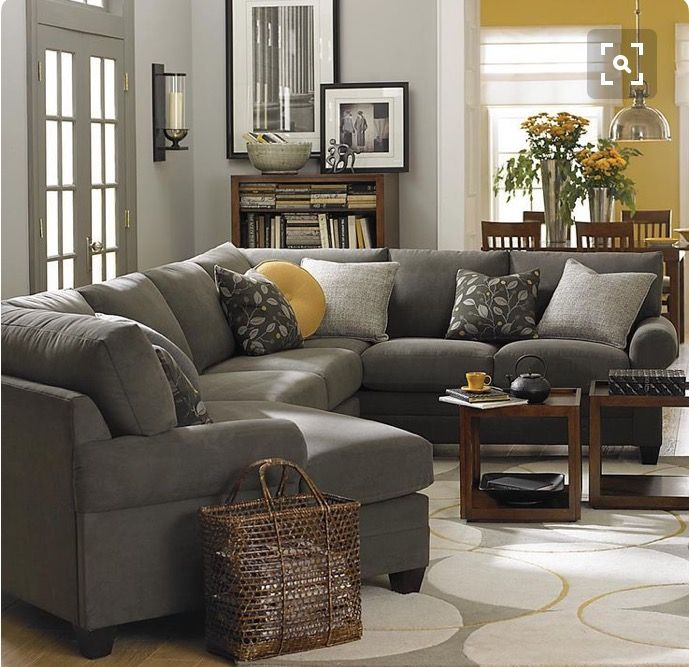 Basset Furniture- Living room gray sectional couch with dark
