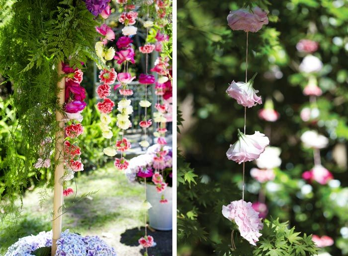 Hanging Flower Curtain Makes A Stunning Backdrop In A #garden #wedding  #ceremony /