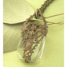 Antique art deco bronze necklace with fancy cut clear crystal pendant