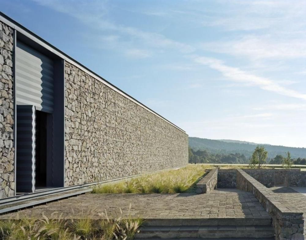 Modern architecture club house stone wall the design of for Modern stone houses architecture