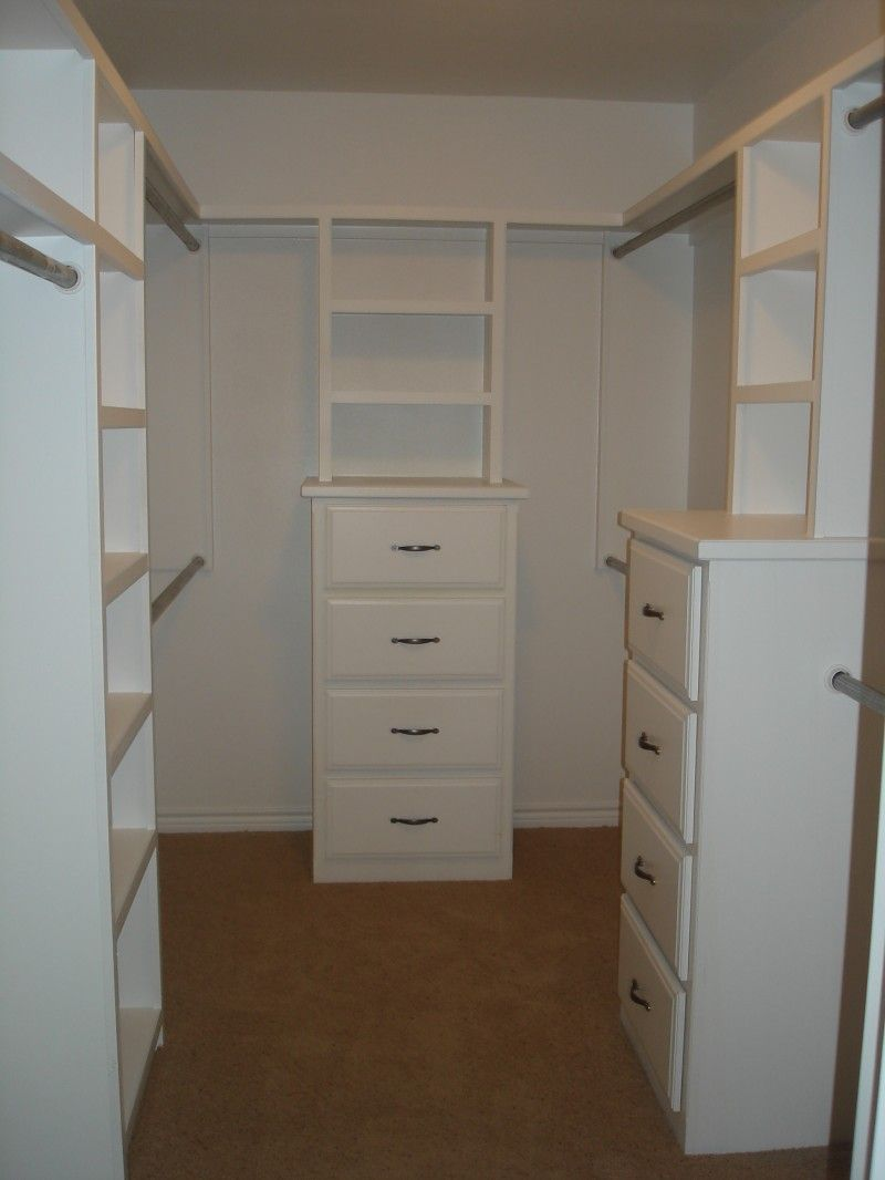 Great built-in layout for a small-ish master closet. Would work really well in ours!