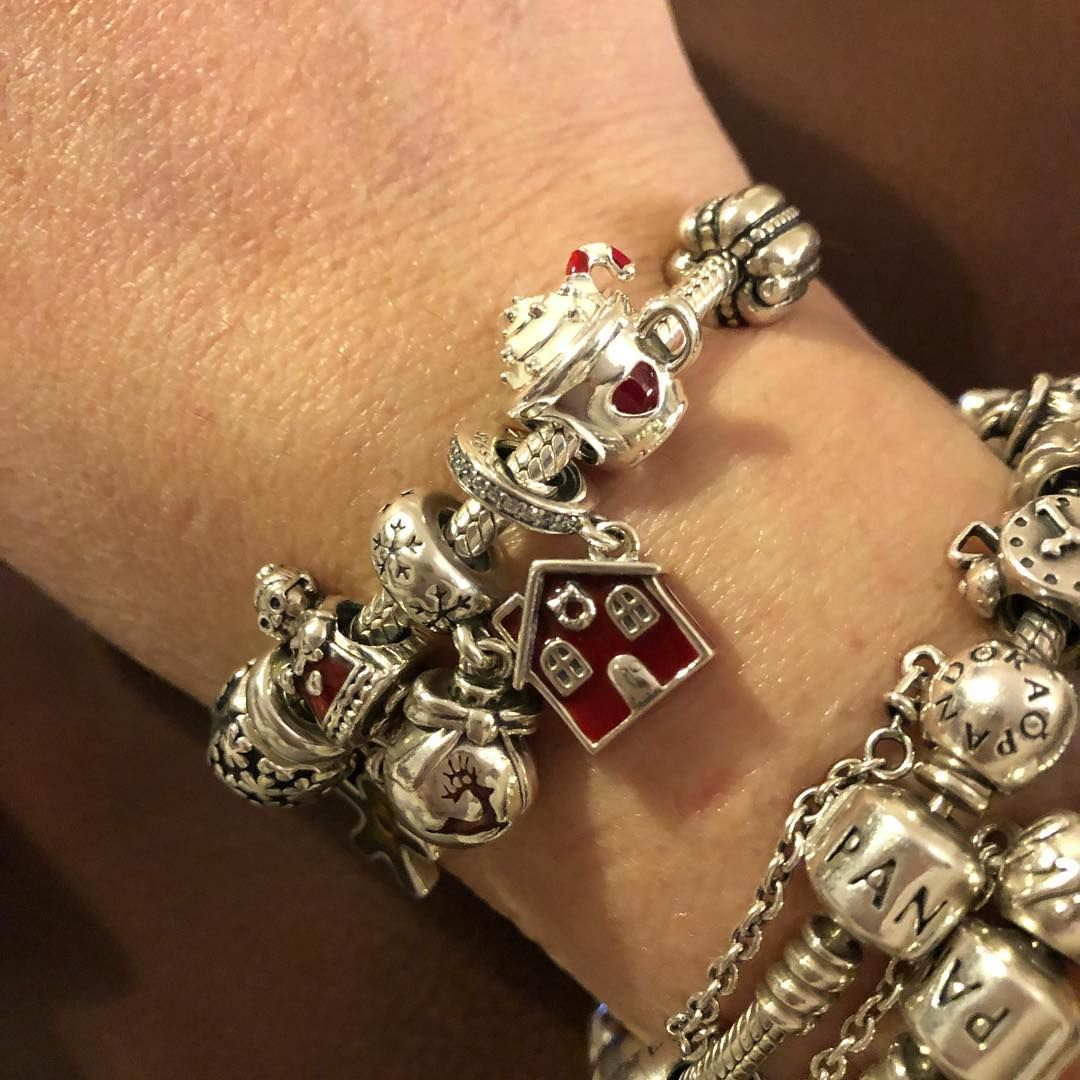 22369e6f100 PANDORA Moments Bracelet complete with warm cocoa charm and cosy Christmas  house.