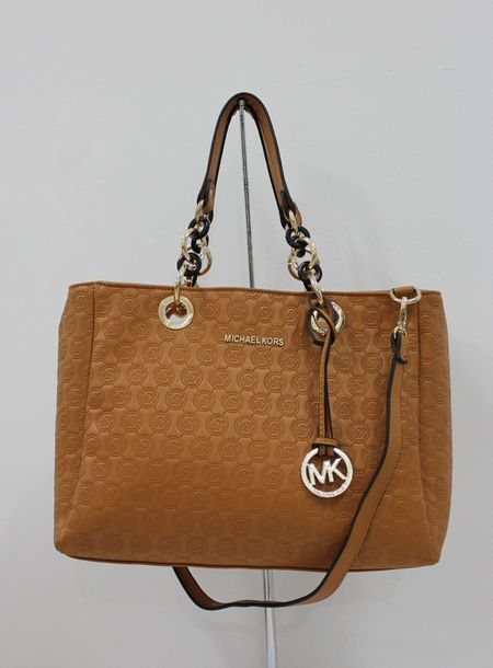 2fd84f206df8ca Michael Michael Kors Jet Set Chain Logo Monogram Jacquard With Luggage  Leather. Some less than $100 OMG! Holy cow, I am gonna love this site!