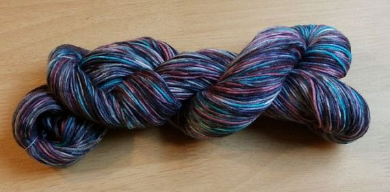 Beta colored Superwash Merino wool sock yarn by MoonJellyFibers