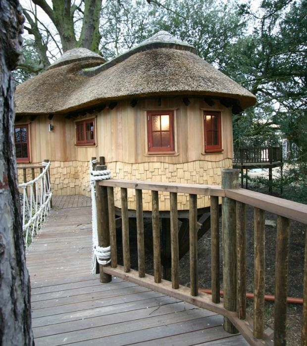 British Castle Tree House - Unique Tree House Homes - Good Housekeeping thatch roof!