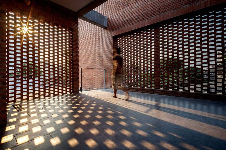 Perforated brick screens create private space admist busy