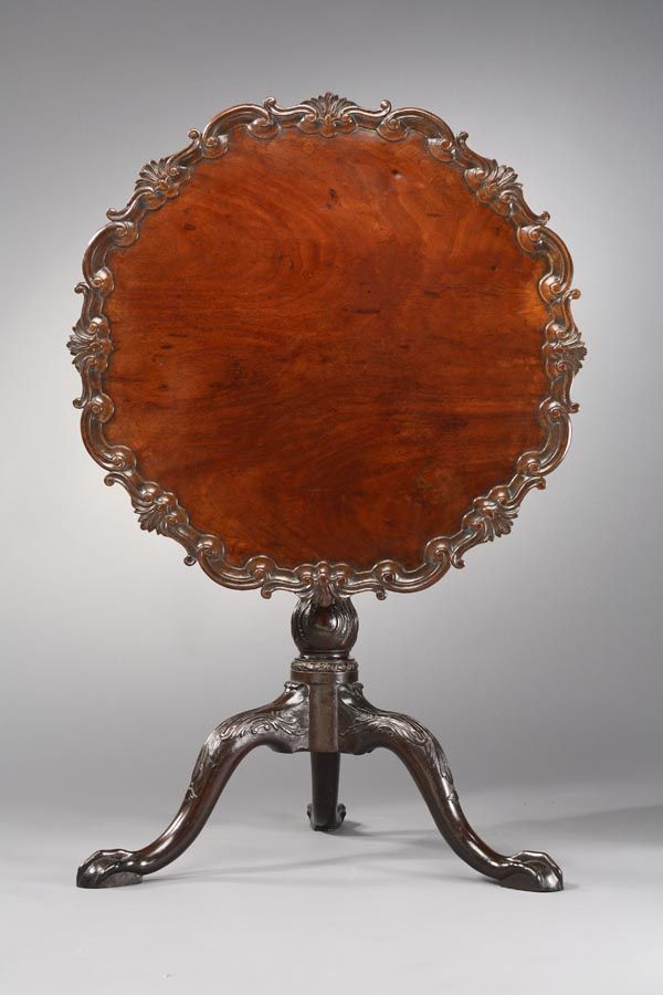 Tilt-top tea tables were important pieces in Colonial America and are still being reproduced today. This one is in the collection of the Museum of Early Southern Decorative Arts in Winston-Salem, NC. It dates from @1750-60 and was probably made by Robert Walker for the Carter family in King George County, Virginia. It's mahogany and cherry with a deeply carved piecrust edge.