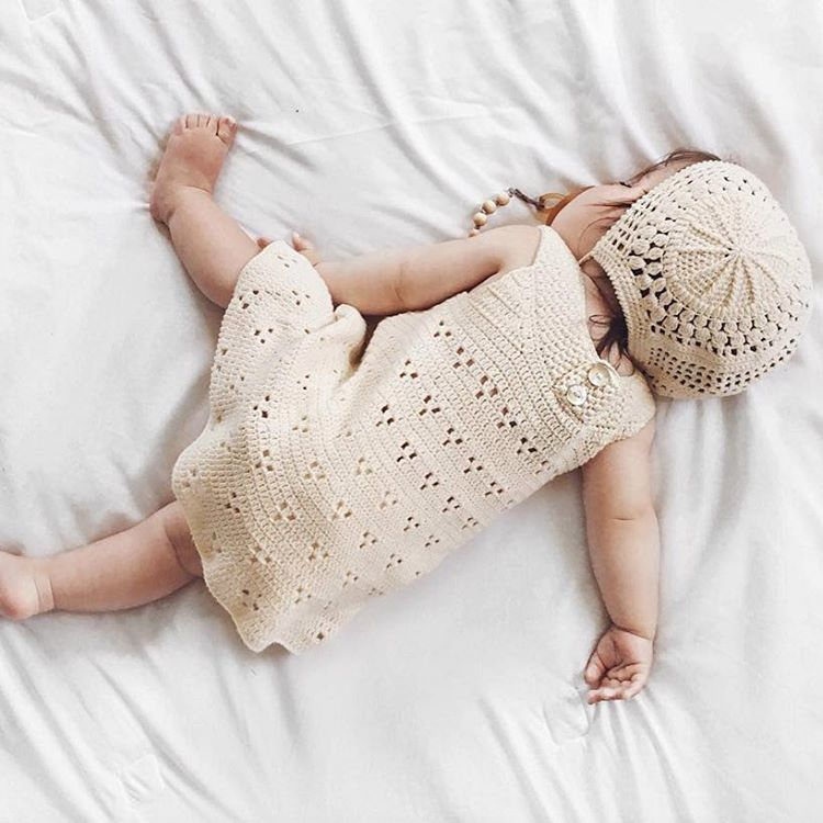 The perfect Sunday activity :) Thank you @wispyfeatherfarm for sharing this sweet photo ❤️ #knittingartistry #rebeccadress #lacebonnet #organiccotton #crochet #babybonnet #crochetdress #babyclothes #organicbaby  www.mioukids.com