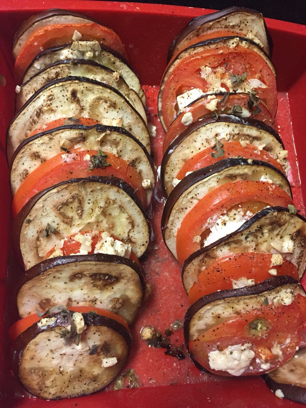 Baked eggplant, tomatoes, and feta cheese.