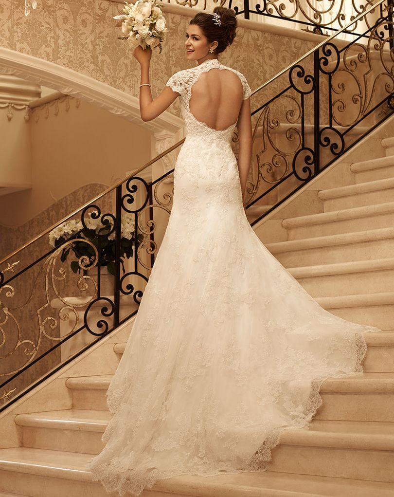 This gown has an attached short sleeve queen anne neckline with key