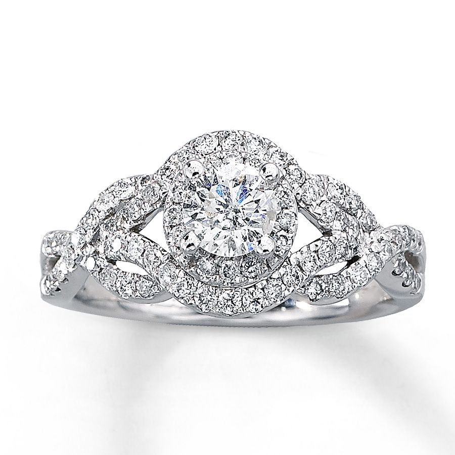 Take Her Breath Away With This Stunning Engagement Ring A Luminous Round  Diamond Is Surrounded