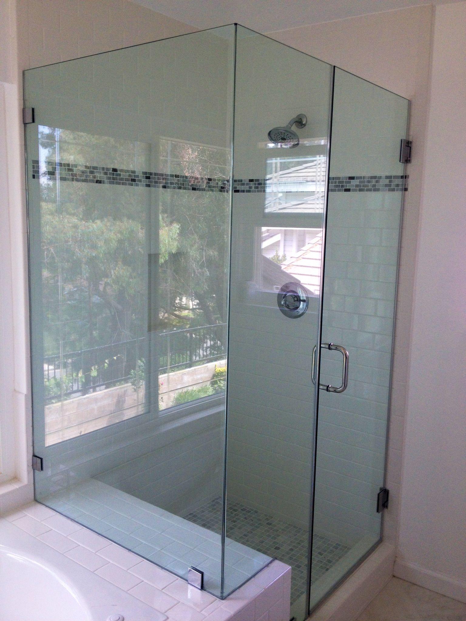 White Tile Accented By Frameless Shower Door By Algamiglassdoors