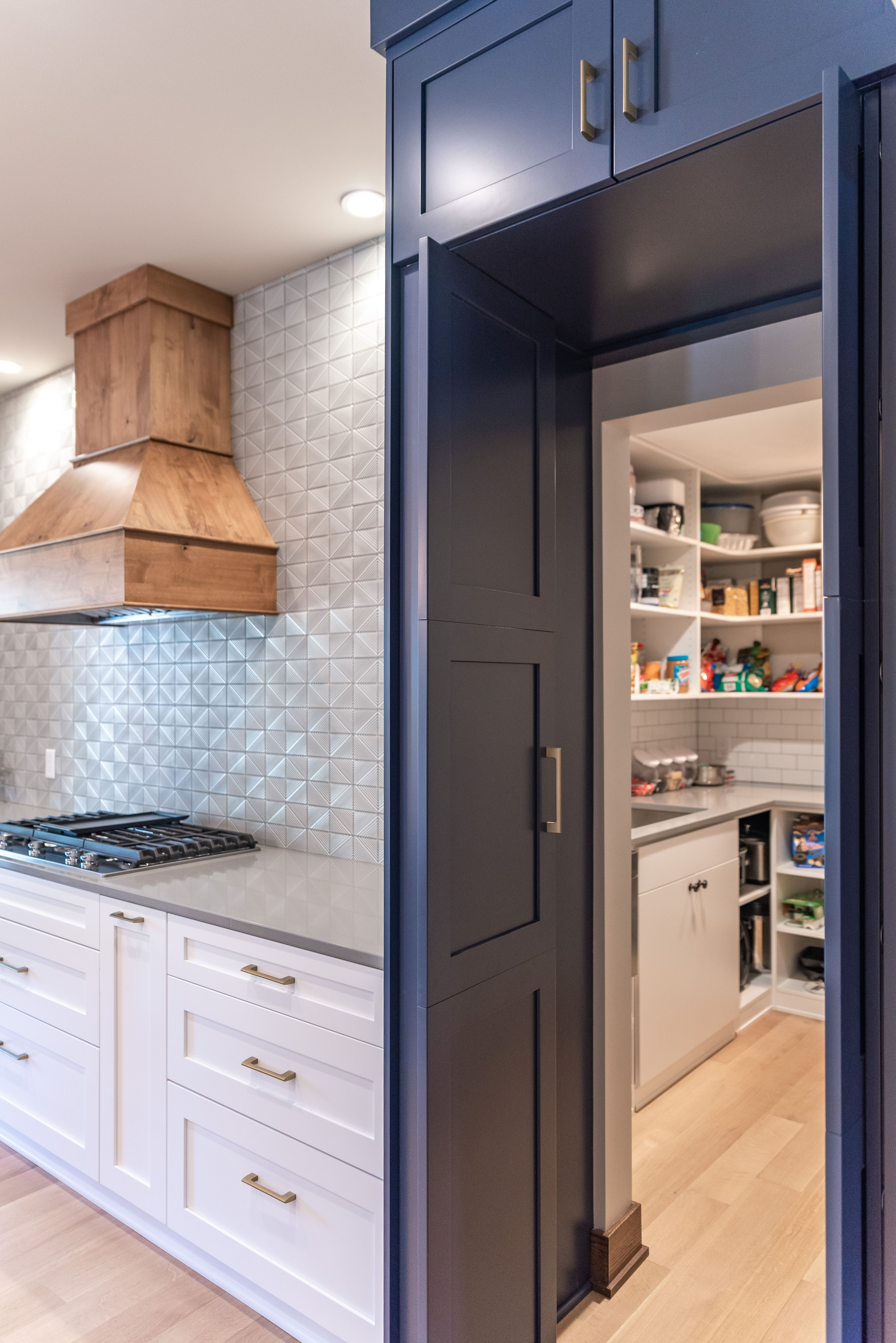 Walk in hidden pantry with BM Hale Navy Cabinets by CKF