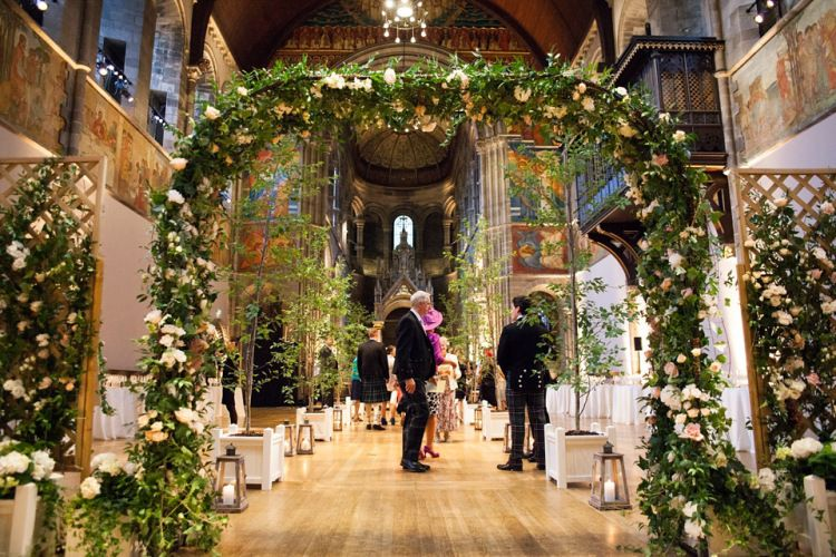 Venue decorated with fresh floral arches and live trees   Photography by http://www.julietinton.com/