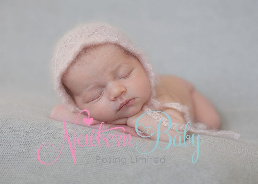 Plain backdrop in a gorgeous shade suitable for both baby boy and girl newborn photography shoots