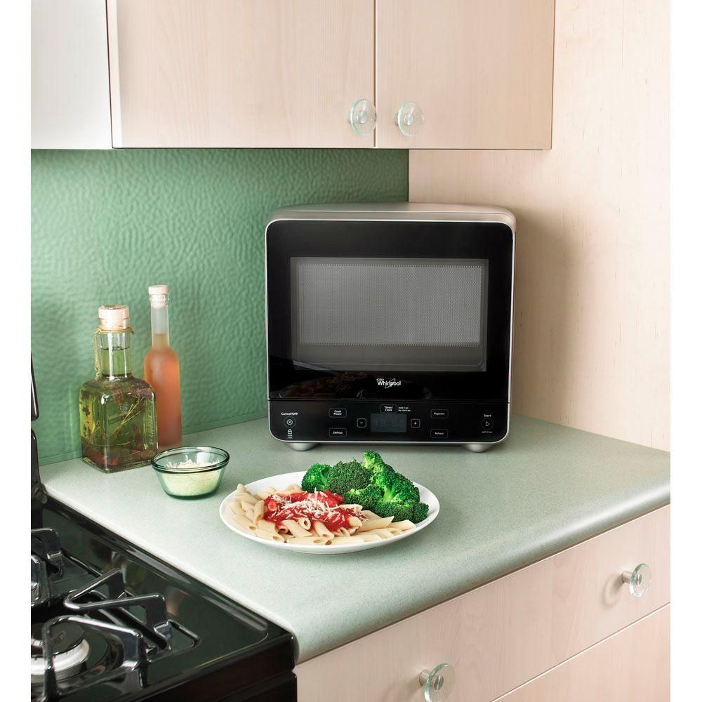 Whirlpool 0 5 Cu Ft Countertop Microwave In Universal Silver