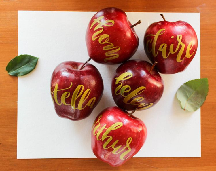 hand lettered apple place cards gold calligraphy