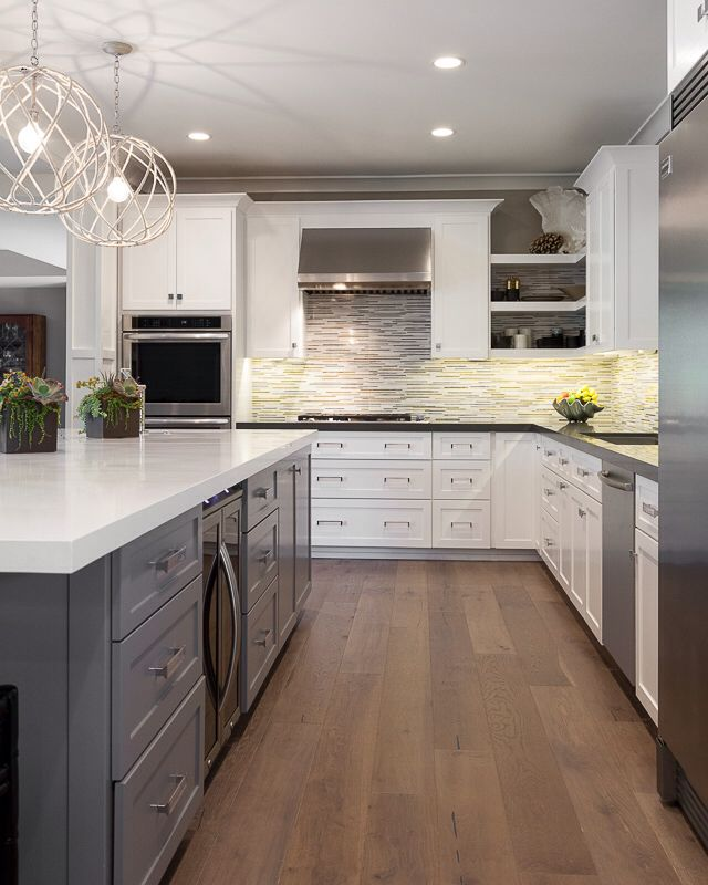 White Cabinets With Grey Caesar Stone Countertops