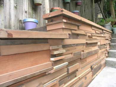 Cinder Block Retaining Wall Covered With Wood Veneer