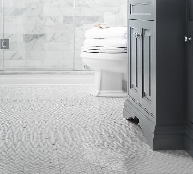 White Bathroom Grey Tiles: Exquisite Bathroom Features A Dark Gray Washstand Atop A