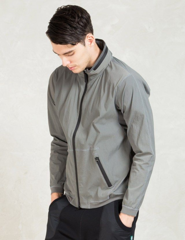 360cebb29e25 REIGNING CHAMP Grey Stretch Nylon Stow Away Hood Jacket Picture ...