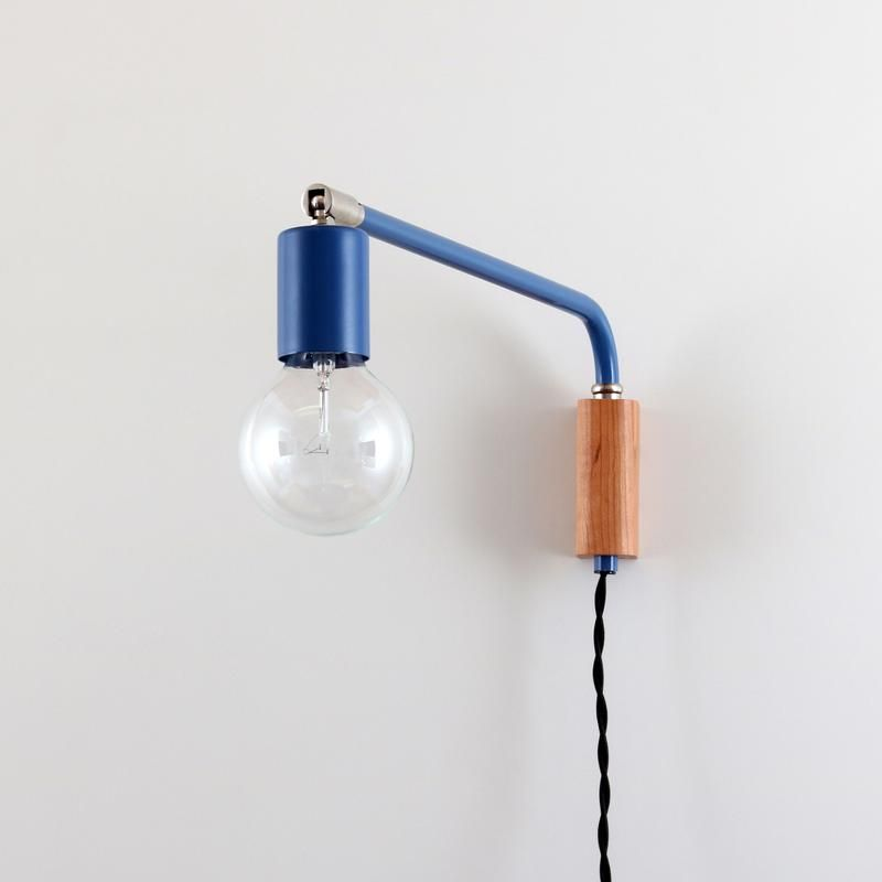 Handmade mid century modern plug in wall lamp pivots side to side available in brass copper or powder coated steel