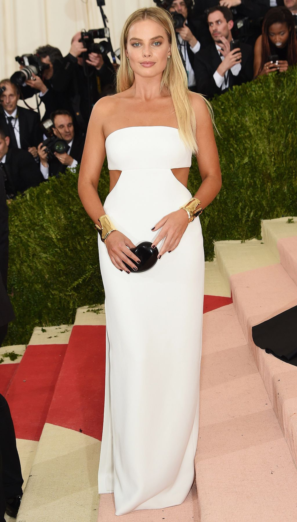3be5134e5b5f MARGOT ROBBIE in Calvin Klein. White cut-out Calvin Klein gown - Met Gala  2016 ...