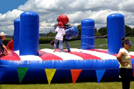 Bouncy Boxing Opponents Take Their Corners In The Inflatable Ring And Come Out Fighting With Hilarious Giant Glove Party Guests Carnival Games Party Rentals